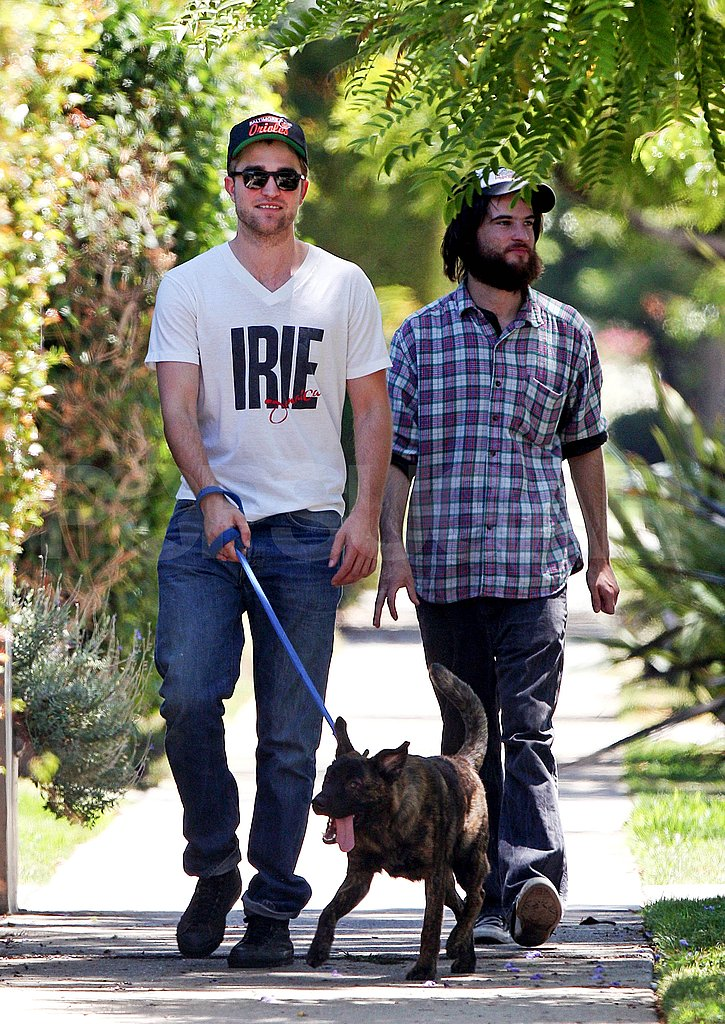 Robert Pattinson and Tom Sturridge without respective girlfriends Kristen Stewart and Sienna Miller.