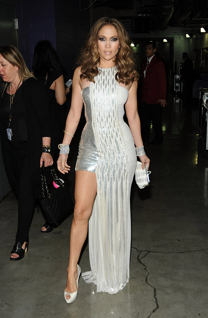 Showing Off Her Toned Gams In A Metallic Versace At The 2010 Grammy Jennifer Lopez 39 S 71