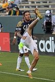 David Beckham does a high kick.