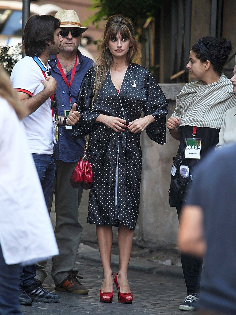 Penelope Cruz covered up in a matching robe.