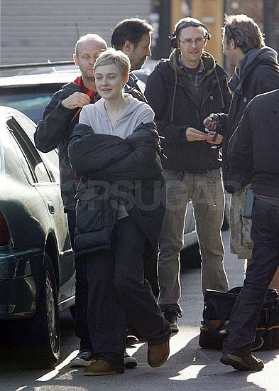 Dakota Fanning bundled up between takes.