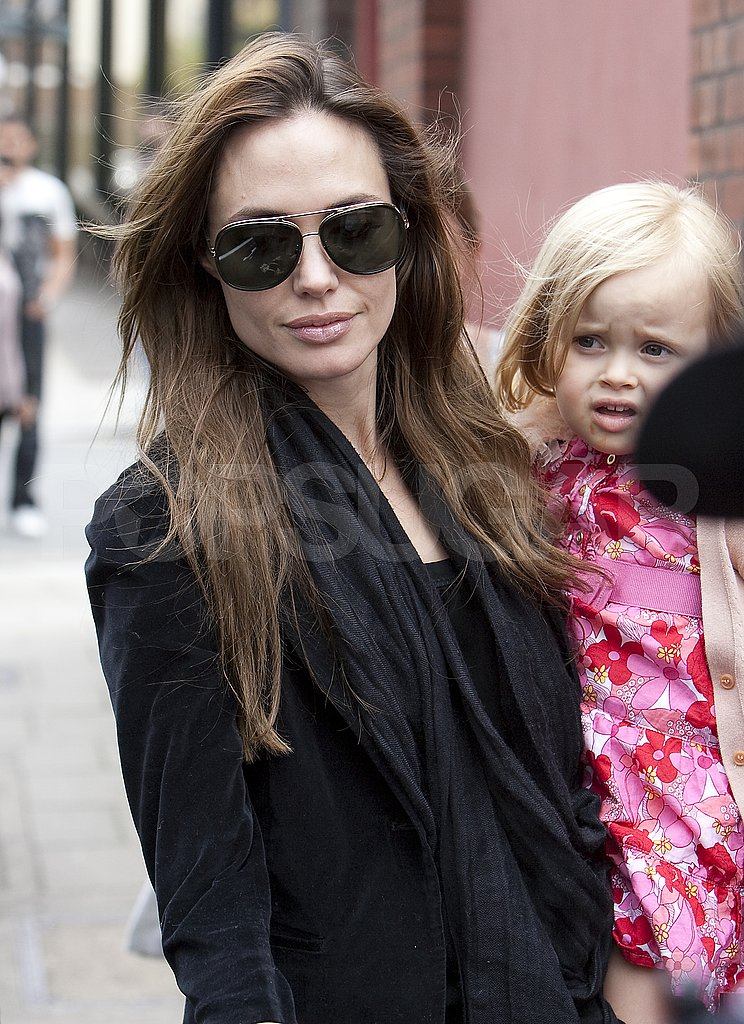 Angelina Jolie carries Vivienne.