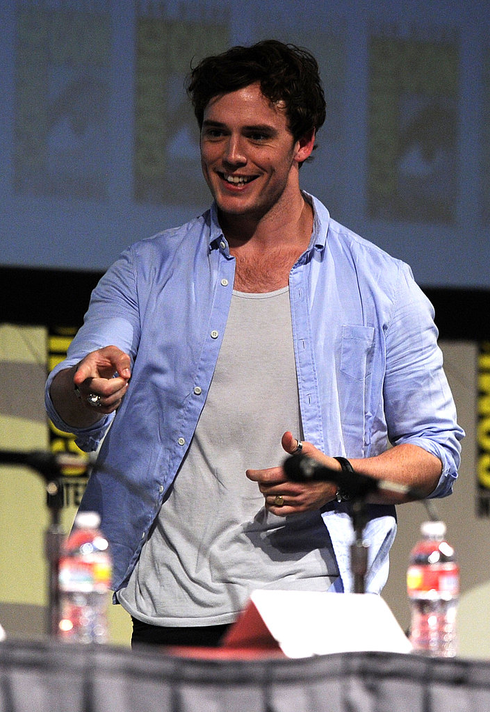 Sam Claflin took the stage in a blue shirt.