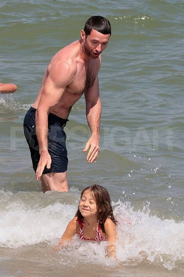 Hugh Jackman swimming shirtless.