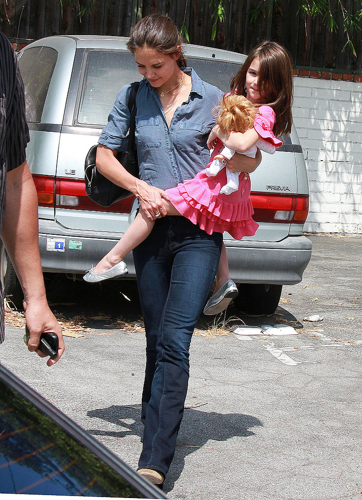 Katie Holmes and Suri Cruise head to a dance store.