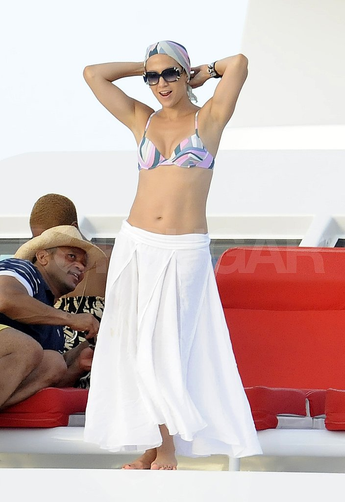 Jennifer Lopez dances in a bikini.