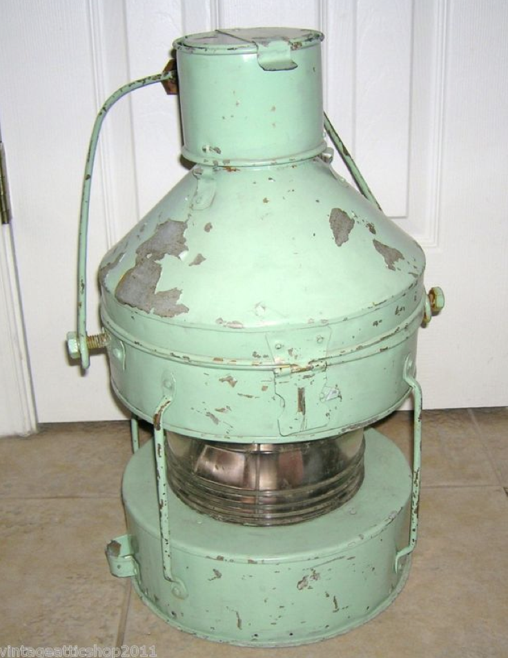 Find some authentic marine antiques to use as décor, such as this Vintage Nautical Boat Green Ship Lantern ($100).