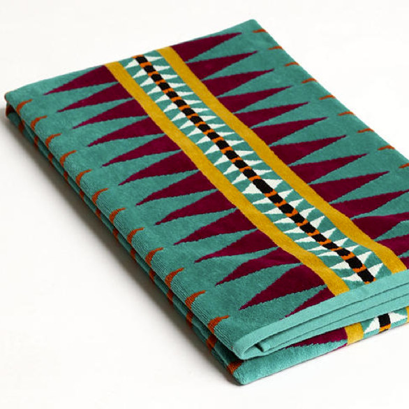 Skip the hot pink beach towels and go with something edgier and patterned like the Pendleton Jacquard Towels ($49).