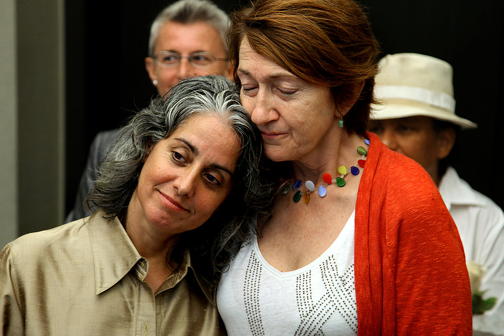 Carol Anastasio and Mimi Brown of New York embrace during their marriage ceremony.