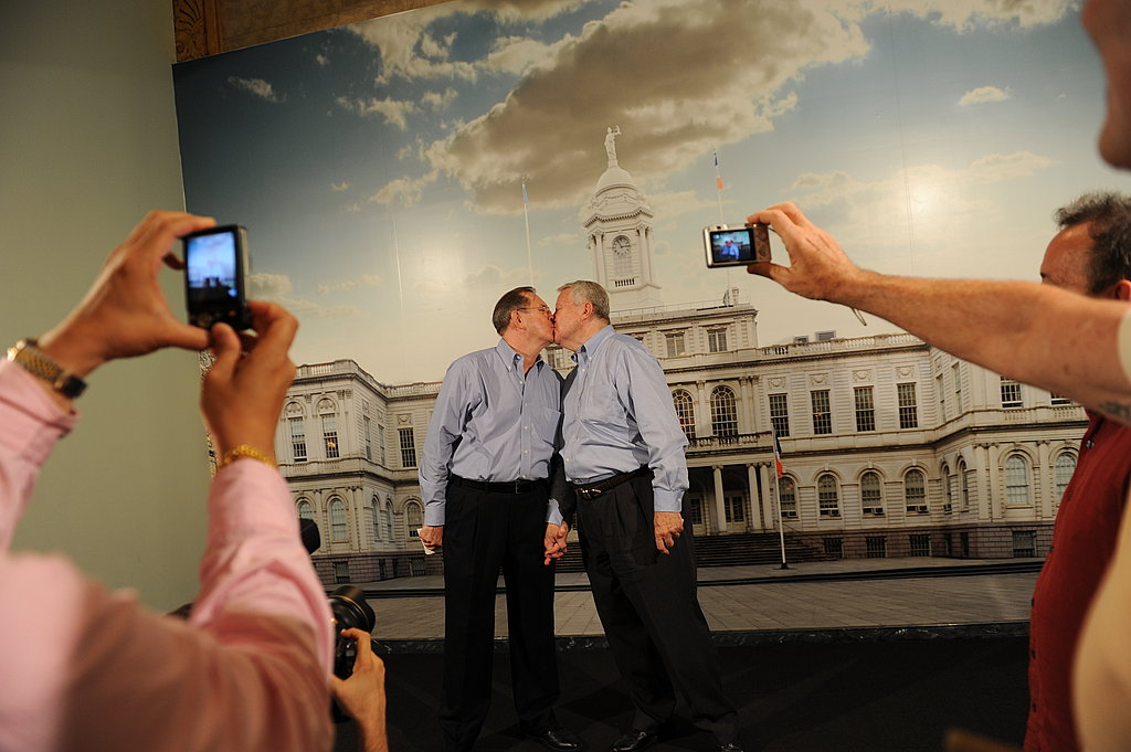 Husbands Ray Durand and Dale Shields share a kiss.