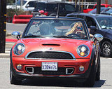 Blake Lively drove a red Mini Cooper.