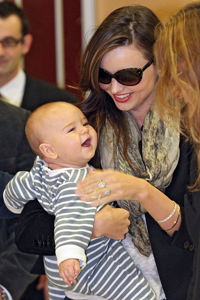 Flynn Bloom and Miranda Kerr arrived in high spirits after their long flight.