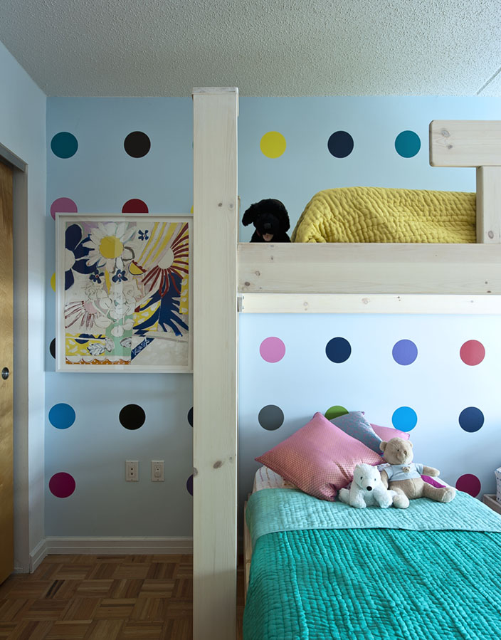 BLIK's Sweet 16 wall decals add a playful touch to the room and coordinate with the tots' Seed Stitch Quilts from Urban Outfitters.