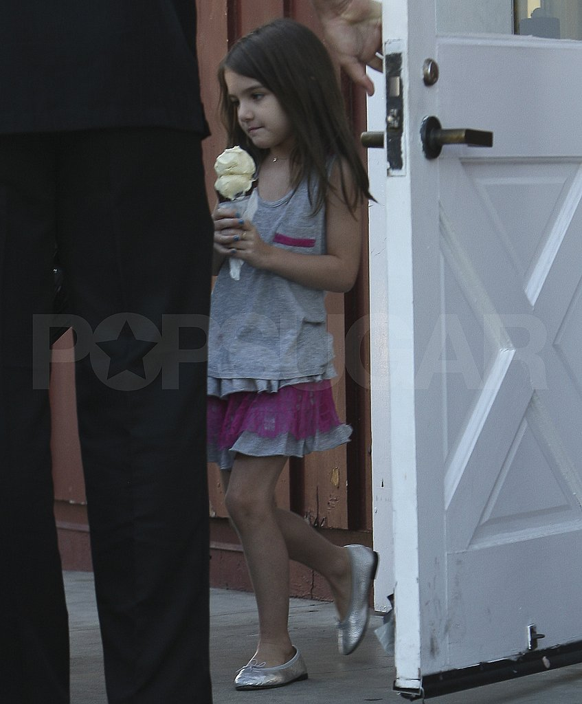 Suri Cruise with an ice cream cone.