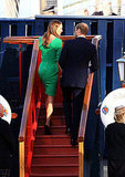 Kate Middleton in a fitted green dress.