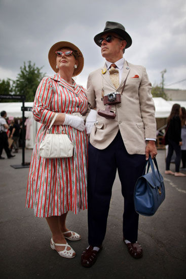 A couple looks adorable in their vintage 'fits.