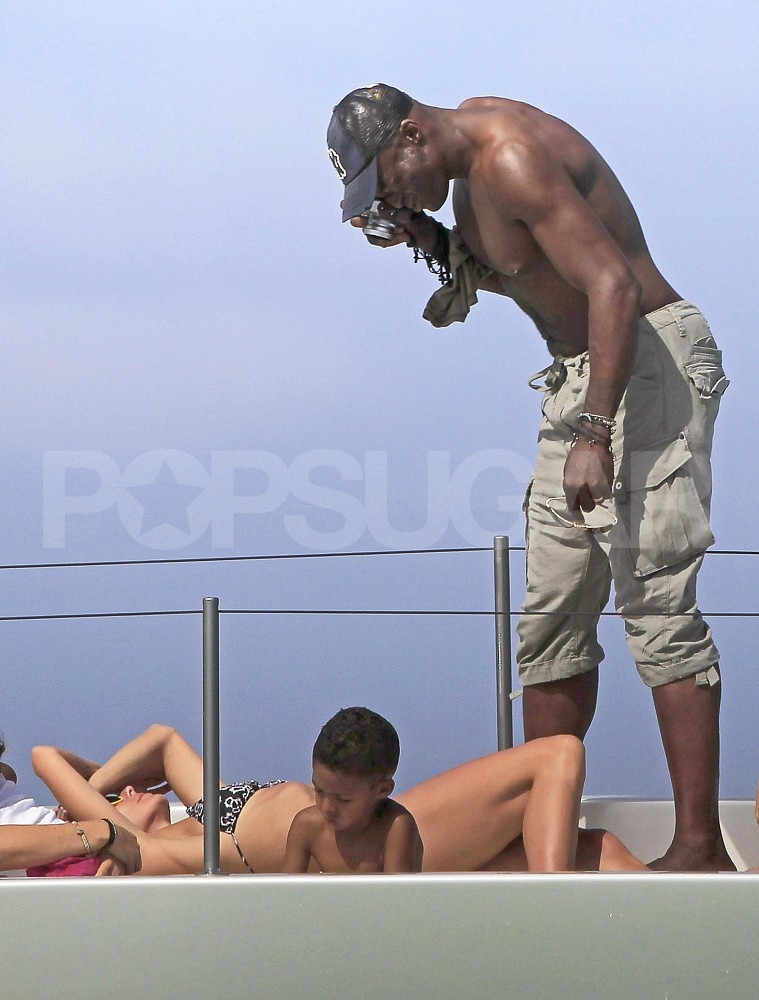 Seal stripped down to snap pictures of his bikini-clad wife Heidi.