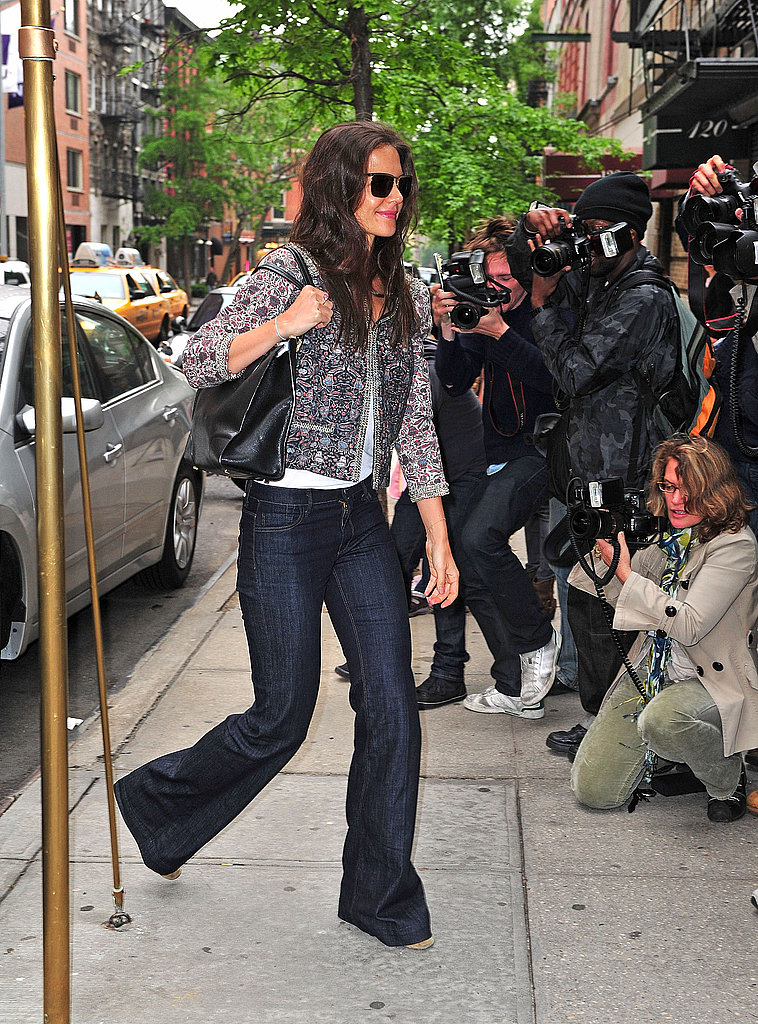 In May 2011, Holmes styled denim with a sophisticated spin via a textured jacket, simple white blouse, and classic pumps.