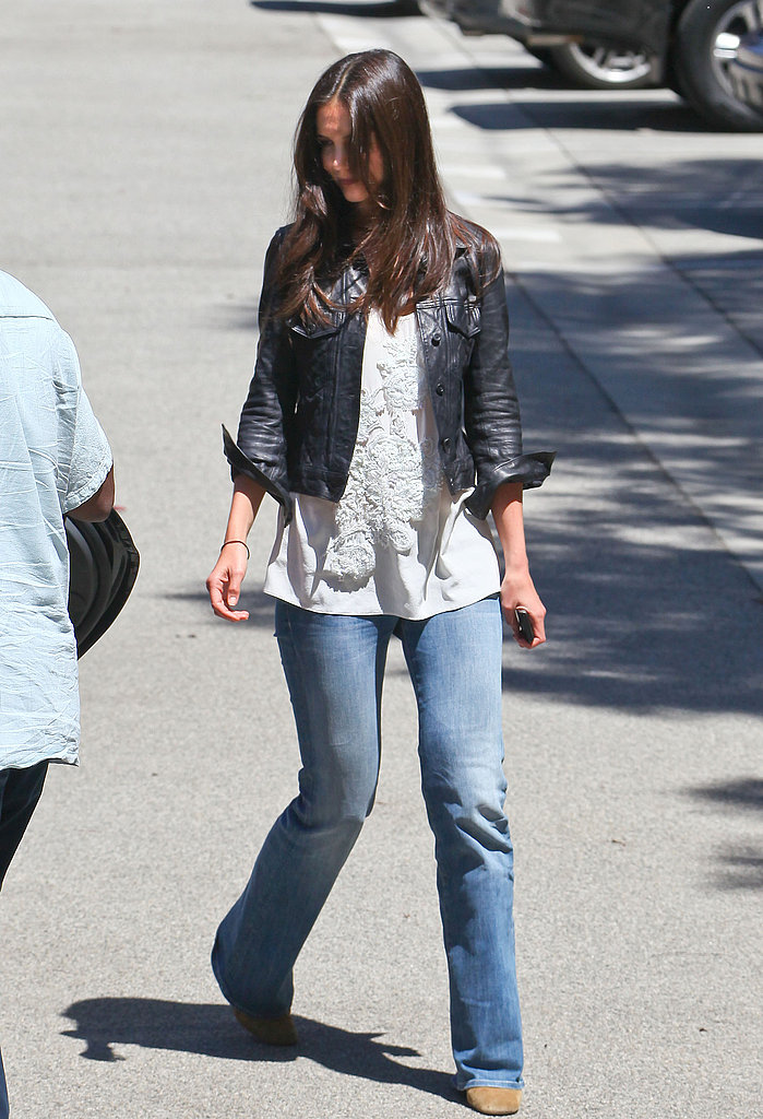 Holmes gave her wide-leg denim and breezy blouse an edgy spin with a leather jacket.