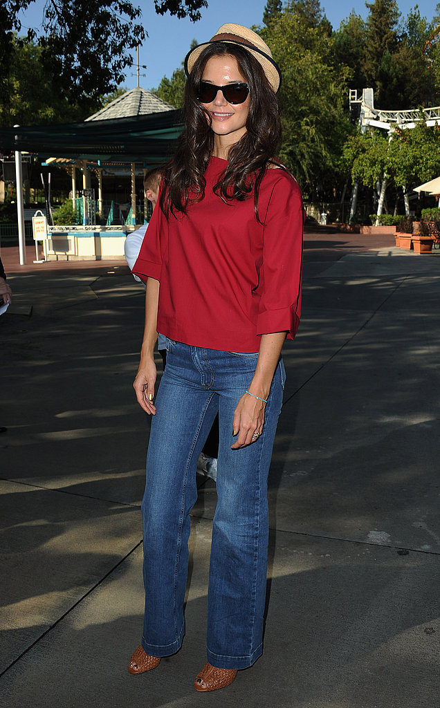 For an easy Summer take on wide-leg denim, pair jeans with a simple top, open-toe booties, and a straw fedora, á la Katie in 2011.