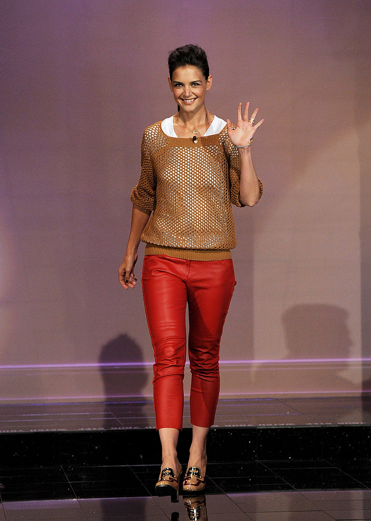 Katie Holmes in red leather pants.