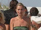 Kate Moss wore a strapless dress.