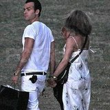 Jennifer Aniston and Justin Theroux hold hands.