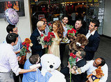 Suitors surround a wax figure of Jennifer Lopez.