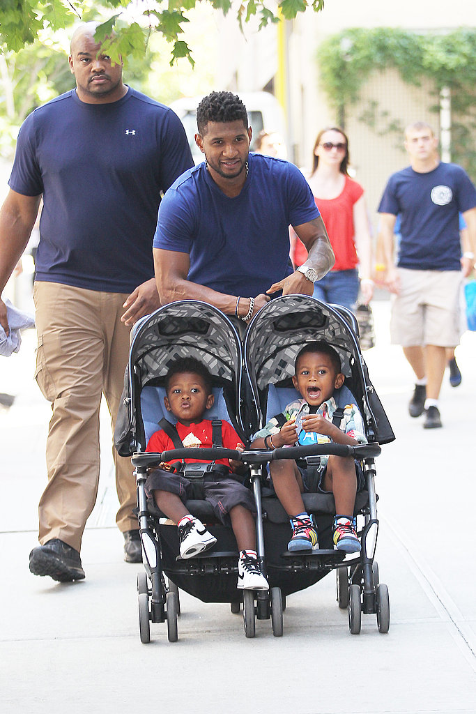 Usher strolling in NYC with his sons in Soho.
