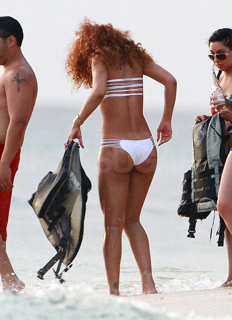 Rihanna Adjusts Her Very Tiny Bikini in Barbados