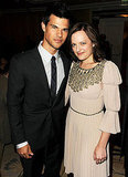 Taylor Lautner caught up with Elisabeth Moss.