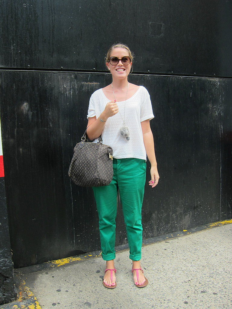 Green trousers add a vibrant pop to this minimal ensemble.