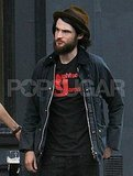 Tom Sturridge sported a bushy beard.
