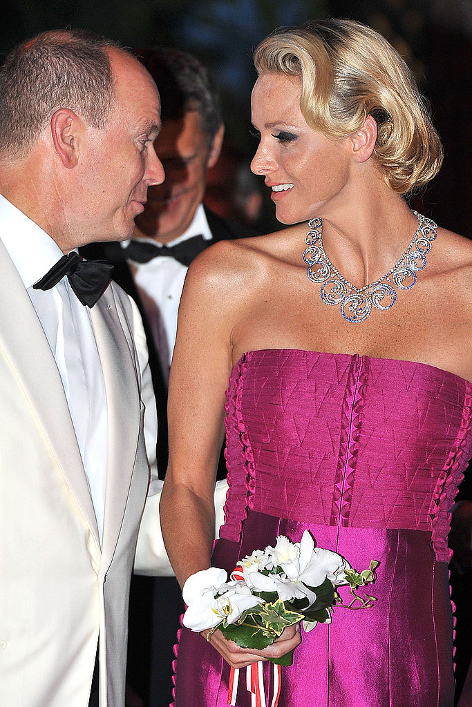 Prince Albert II and his wife Charlene chat at the gala.