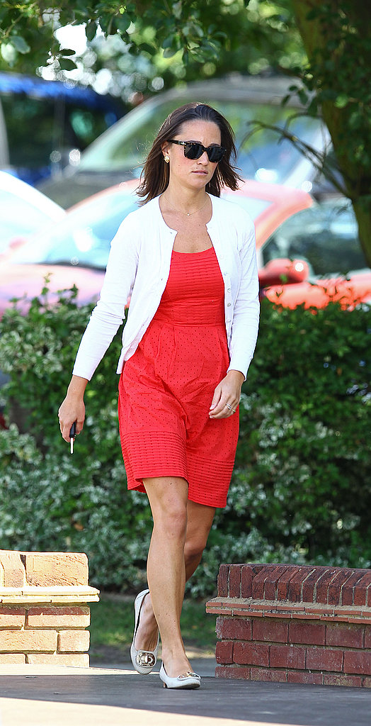 Pippa arrived in a white cardigan.
