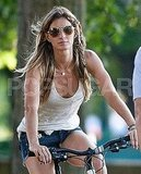 Gisele wore short shorts for her bike ride.