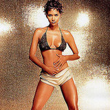 Halle Berry wore a lacy black bikini top and short shorts for her January 2003 FHM UK photo shoot.