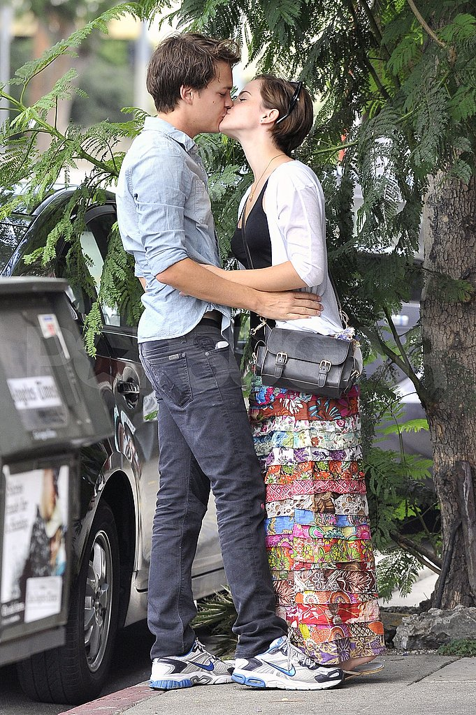 Emma Watson and Johnny Simmons kiss.