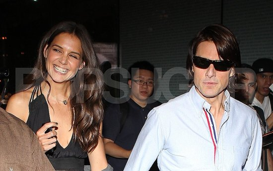 Katie Holmes and Tom Cruise leave dinner.