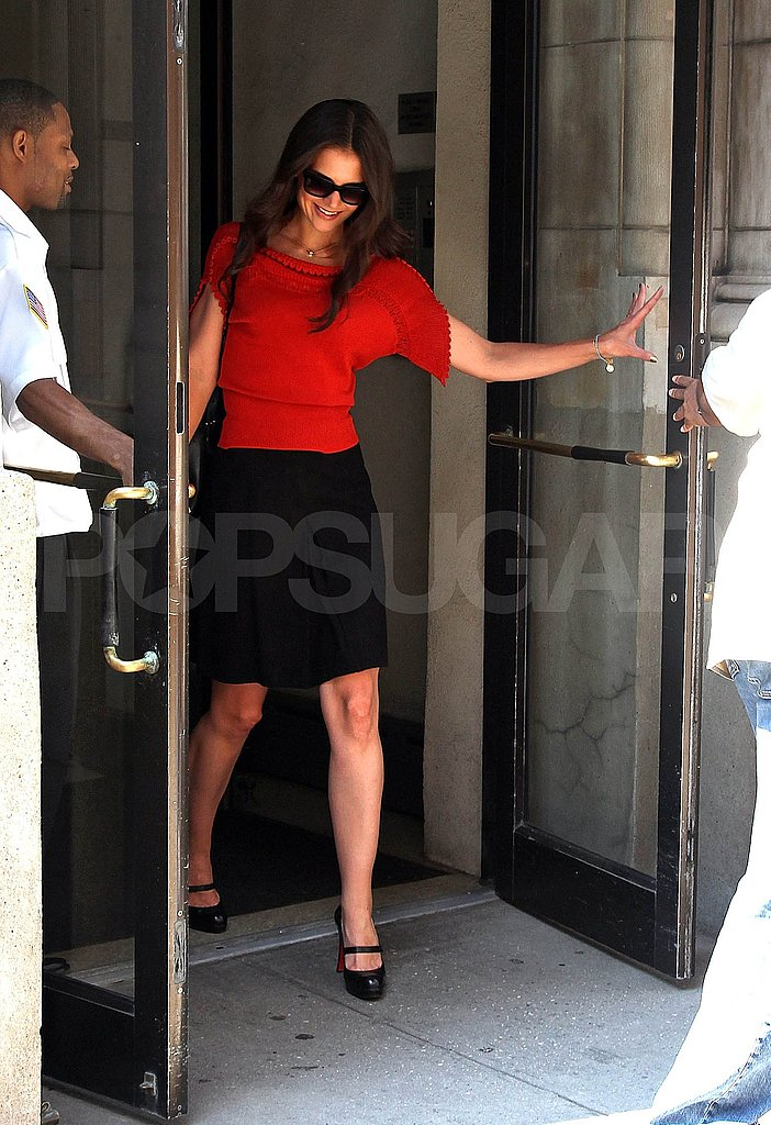 Katie Holmes leaves to do press.