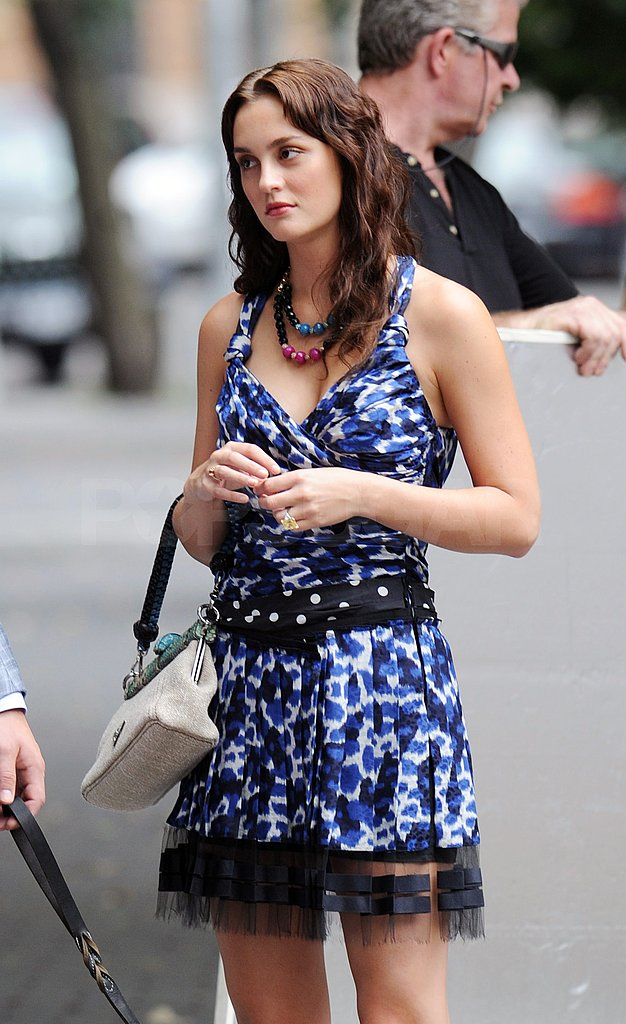 Leighton Meester paused for a moment on the NYC set of Gossip Girl.