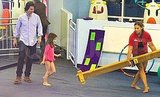 Tom Cruise and Suri Cruise at gymnastics.
