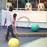 Tom Cruise and Suri Cruise hanging out.