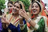 Indian college girls celebrate the Teej festival at Khalsa college for women in Amritsar.