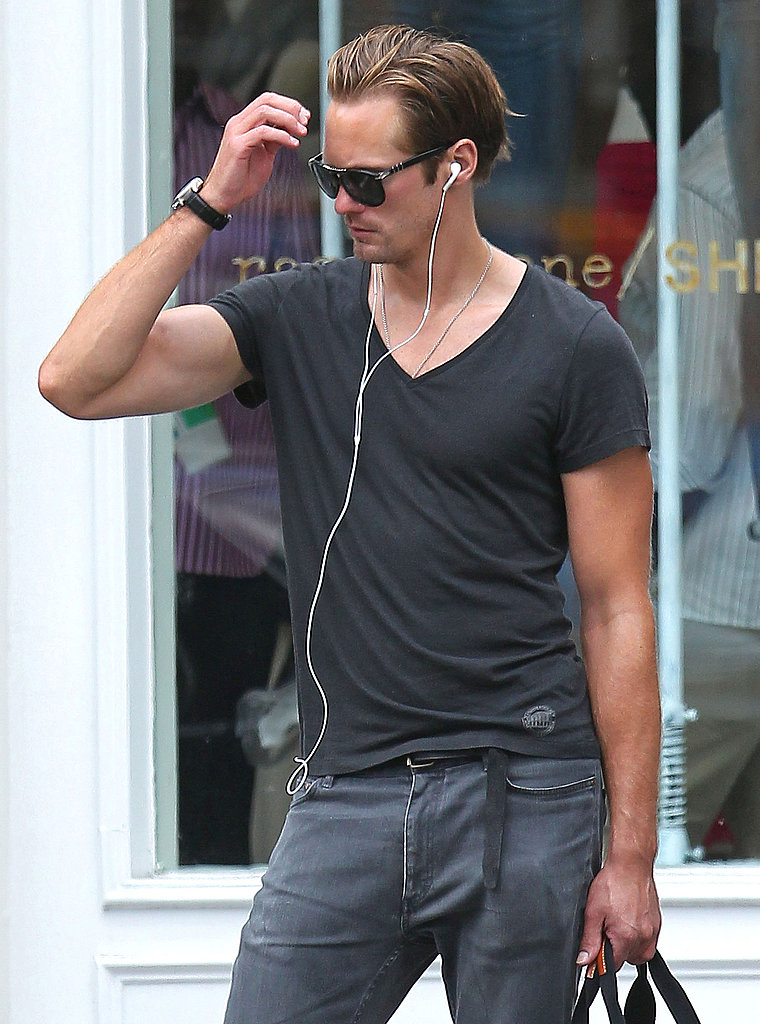 Alexander Skarsgard with his headphones on.