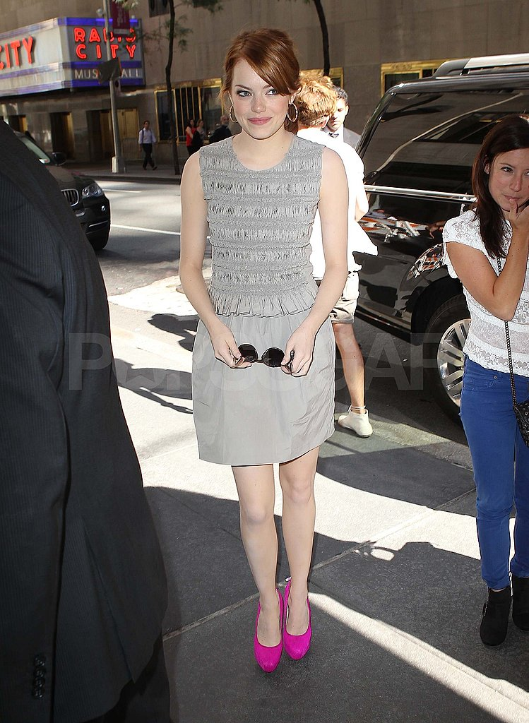 Emma Stone wears hot pink heels in NYC.