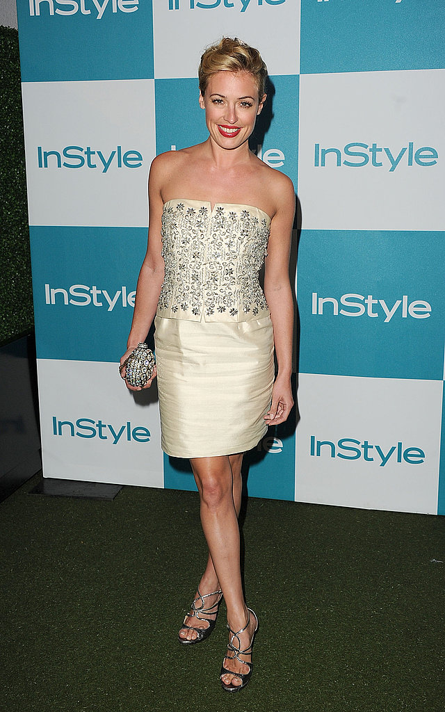 Cat Deely sparkled in an embroidered strapless dress.