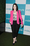 Michelle Trachtenberg opted for hot pink blazer, printed top, and black trousers.