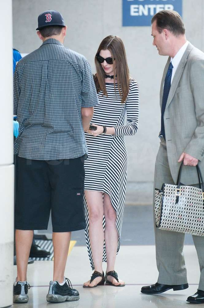 Anne Hathaway had some help with her bags.