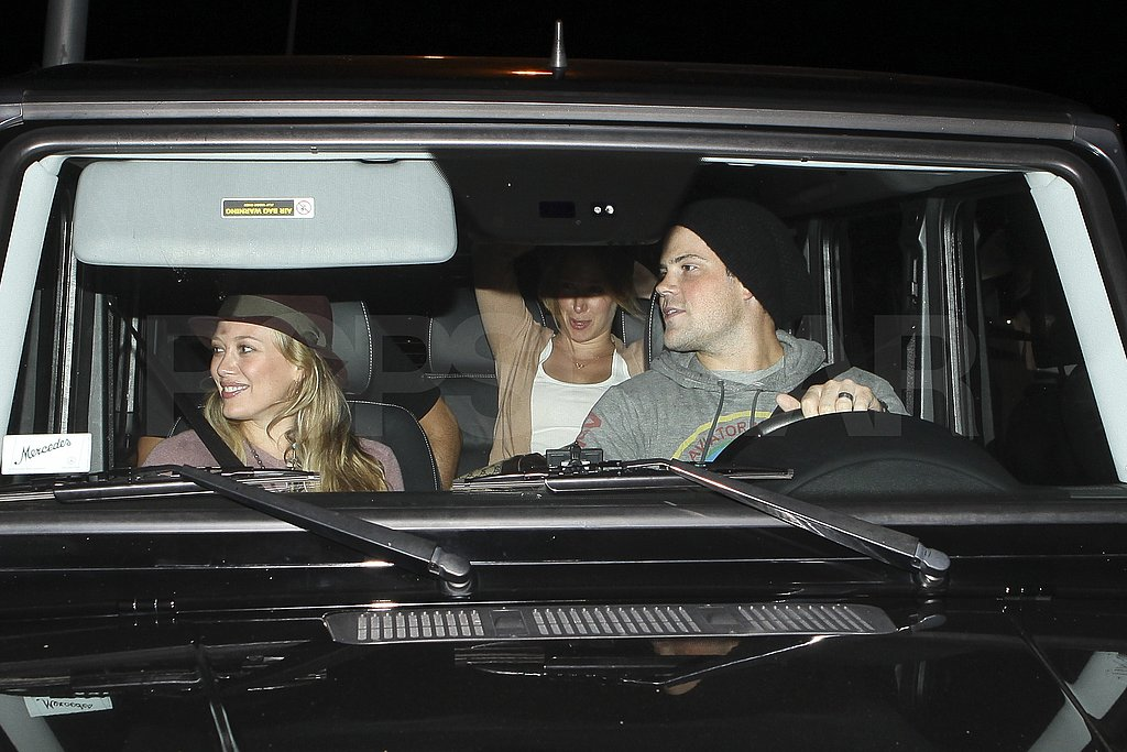 Mike Comrie drove Hilary home in their SUV.